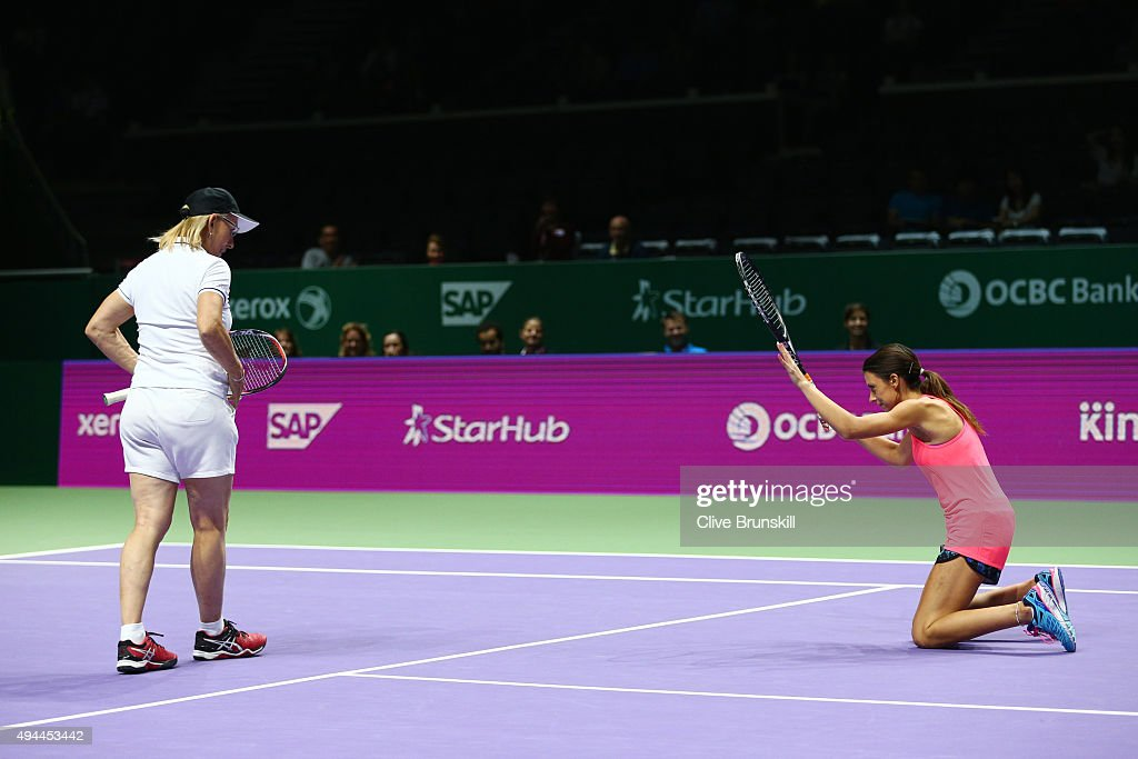 <a gi-track='captionPersonalityLinkClicked' href=/galleries/search?phrase=Martina+Navratilova&family=editorial&specificpeople=201523 ng-click='$event.stopPropagation()'>Martina Navratilova</a> of the USA and <a gi-track='captionPersonalityLinkClicked' href=/galleries/search?phrase=Marion+Bartoli&family=editorial&specificpeople=227896 ng-click='$event.stopPropagation()'>Marion Bartoli</a> of France in action against Tracy Austin of the USA and Arantxa Sanchez-Vicario of Spain in a legends match during the BNP Paribas WTA Finals at Singapore Sports Hub on October 27, 2015 in Singapore.