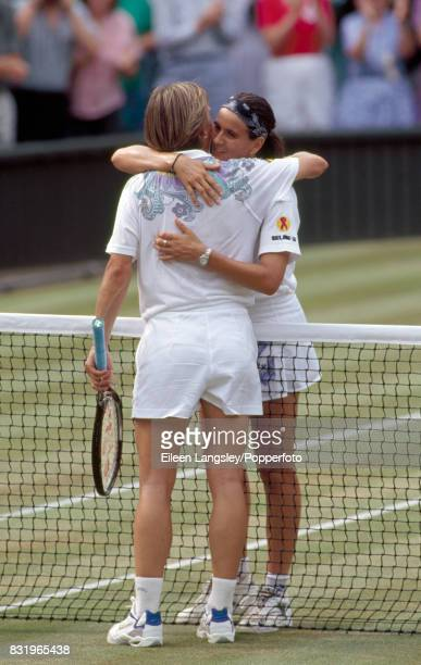 Martina Navratilova of the USA congratulates Conchita Martinez of Spain winner of their women's singles final during the Wimbledon Lawn Tennis...