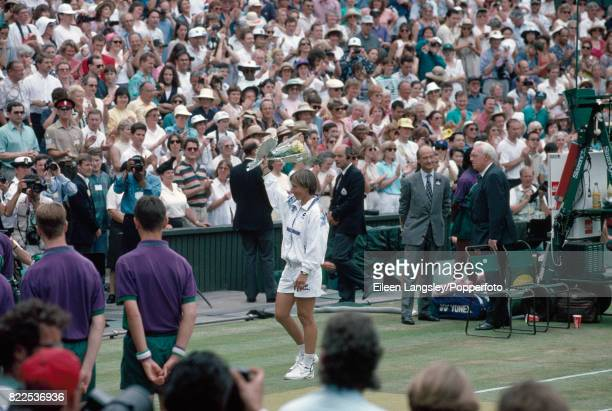 Martina Navratilova of the USA leaves the court to the applause of the crowd after her semifinal defeat by Jana Novotna of Czechoslovakia in straight...