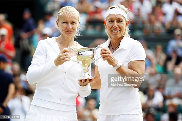 Martina Navratilova of USA and Jana Novotna of Czech Republic celebrate winning the Ladies Invitational Doubles Final against Tracy Austin and Kathy...