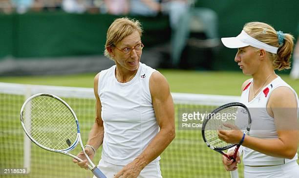 Martina Navratilova of USA talks to Svetlana Kuznetsova of Russia during the ladies dubble match against Helen Crook and Anna Hawkins of Great...