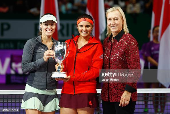 Martina Navratilova poses with Martina Hingis of Switzerland and Sania Mirza of India as they hold up the Martina Navratilova Doubles Trophy after...