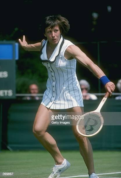 Martina Navratilova runs to hit the ball during a match at Wimbledon in England