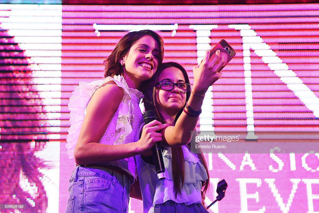 <a gi-track='captionPersonalityLinkClicked' href=/galleries/search?phrase=Martina+Stoessel&family=editorial&specificpeople=11048236 ng-click='$event.stopPropagation()'>Martina Stoessel</a> poses for a selfie during the 'Meet And Greet With Tini' at Qube on April 30, 2016 in Rome, Italy.