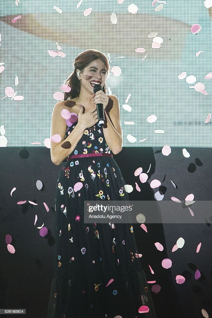 Martina Stoessel sings a track of Tini during the premiere of Tini-La nuova vita di Violetta at Auditorium Parco della Musica on April, 29, 2016 in Rome, Italy.