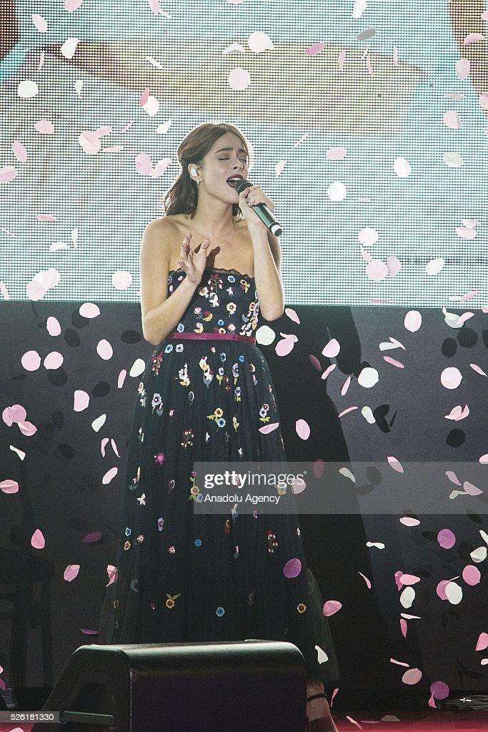 Martina Stoessel sings a track of Tini during the premiere of Tini-La nuova vita di Violetta at Auditorium Parco della Musica on April, 29, 2016 in Rome, Italy.