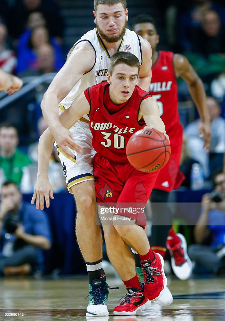 Martinas Geben #23 of the Notre Dame Fighting Irish defends from behind as Ryan McMahon #30 of the Louisville Cardinals reaches for the ball at Purcell Pavilion on January 4, 2017 in South Bend, Indiana.