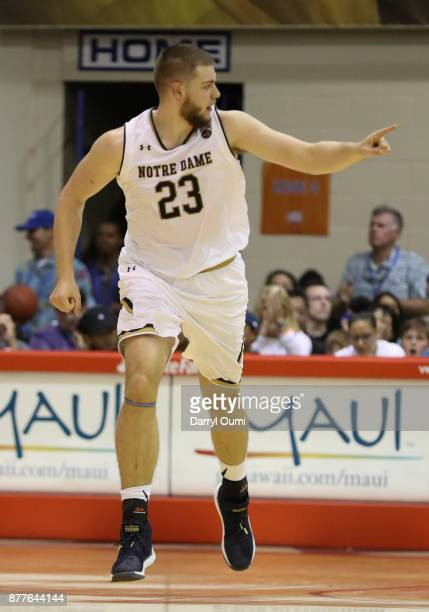 Martinas Geben of the Notre Dame Fighting Irish gestures to he's teammate after scoring a basket during the second half at the Maui Invitational at...