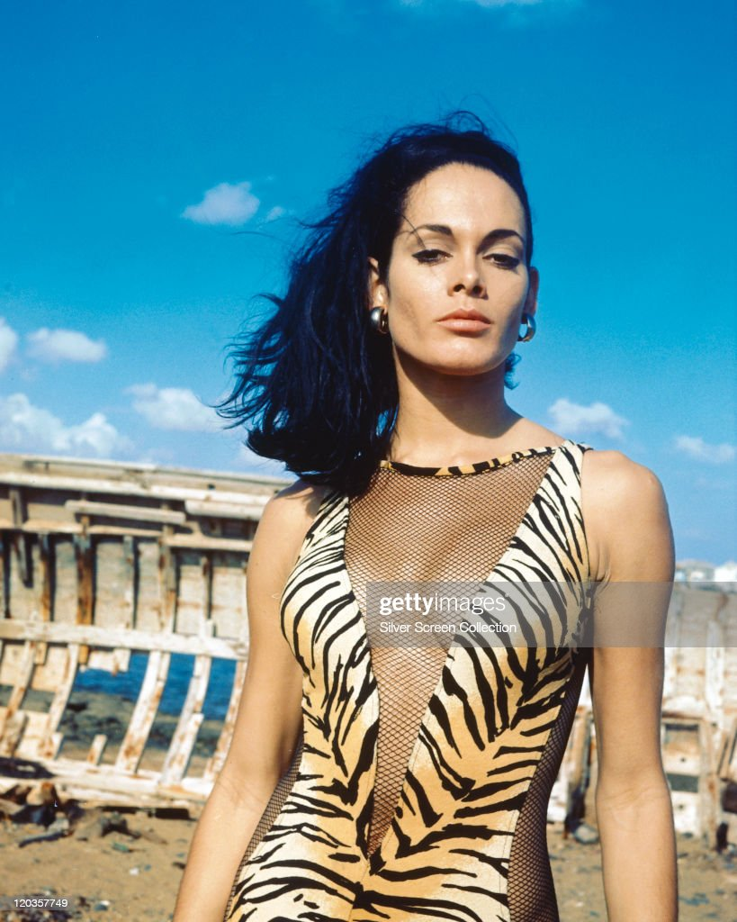 <a gi-track='captionPersonalityLinkClicked' href=/galleries/search?phrase=Martine+Beswick&family=editorial&specificpeople=861365 ng-click='$event.stopPropagation()'>Martine Beswick</a>, British actress and model, wearing a tiger skin print swimsuit with fishnet cut-outs in a 'V' across the front as well as up the side, circa 1965.