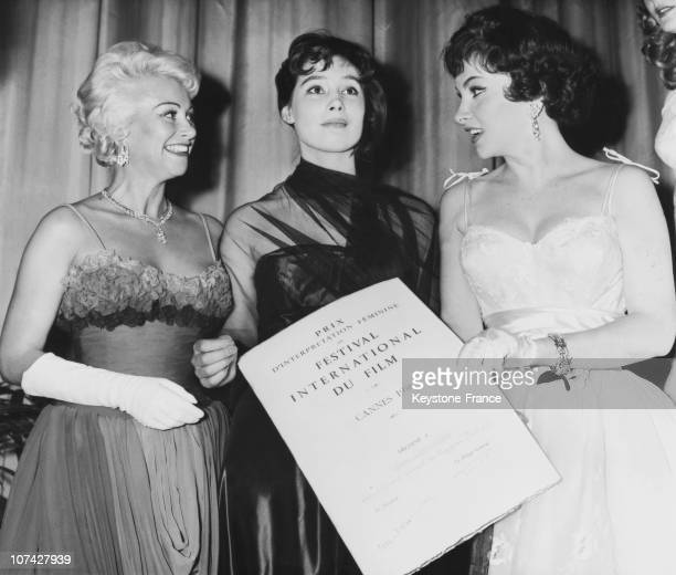Martine Carol And Gina Lollobrigida Giving The Diploma Of The Gold Palm To Tatiana Samoilova In Cannes In FranceEurope On May 20Th 1958