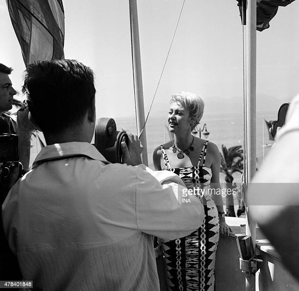 Martine Carol in front of cameras during the Cannes film festival during the shooting of the program ''Reflections of Cannes''