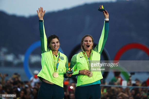Martine Grael of Brazil and Kahena Kunze of Brazil celebrate winning gold in the Women's 49er FX class at the Marina da Gloria on Day 13 of the 2016...