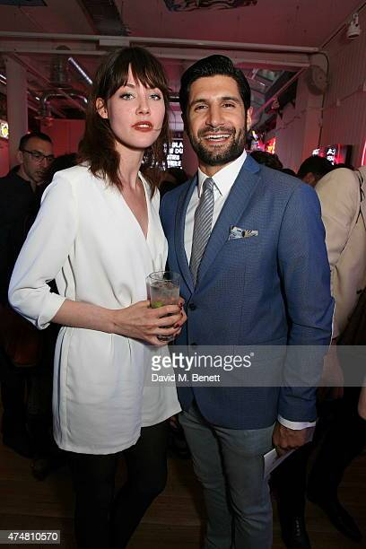 Martine Lervik and Kayvan Novak attend the Lights of Soho private view on May 26 2015 in London England