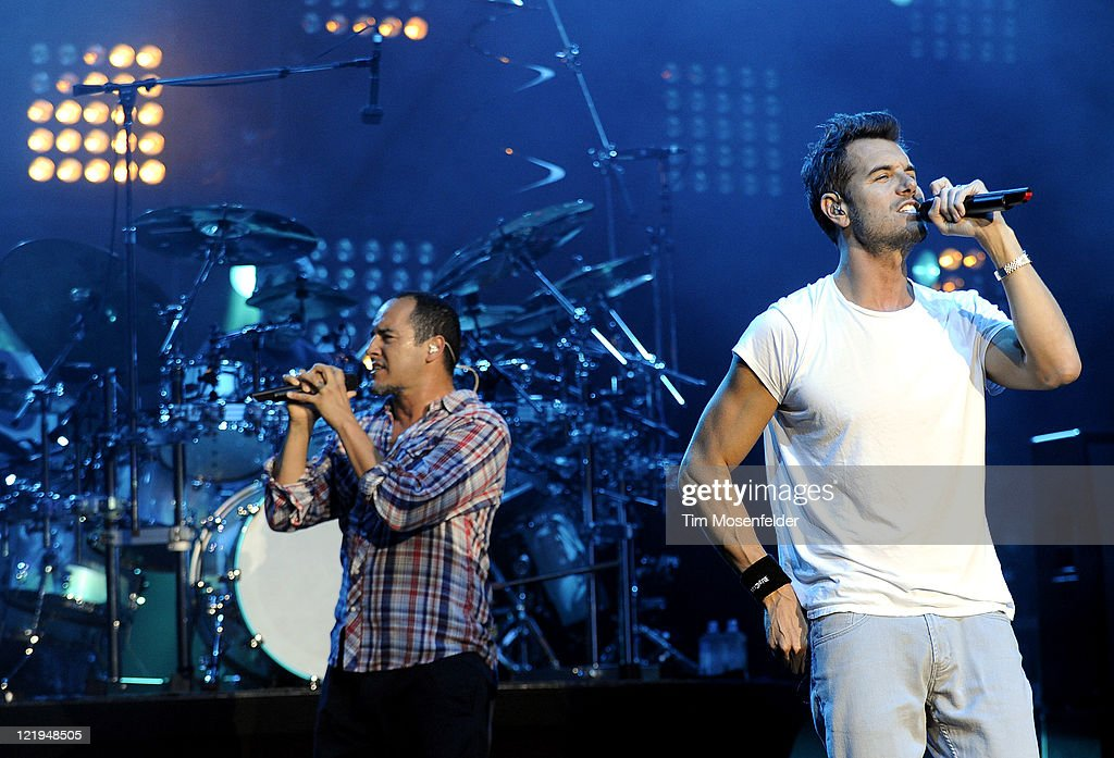S.A. Martinez (L) and Nick Hexum of 311 perform in support of the bands' Universal Pulse at Shoreline Amphitheater on August 23, 2011 in Mountain View, California.