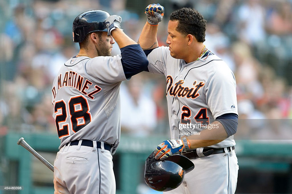 <a gi-track='captionPersonalityLinkClicked' href=/galleries/search?phrase=J.D.+Martinez&family=editorial&specificpeople=7520024 ng-click='$event.stopPropagation()'>J.D. Martinez</a> #28 celebrates with <a gi-track='captionPersonalityLinkClicked' href=/galleries/search?phrase=Miguel+Cabrera&family=editorial&specificpeople=202141 ng-click='$event.stopPropagation()'>Miguel Cabrera</a> #24 of the Detroit Tigers after Cabrera hit a solo home run during the eighth inning against the Cleveland Indians a Progressive Field on September 1, 2014 in Cleveland, Ohio.