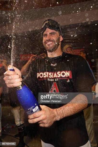 D Martinez of the Arizona Diamondbacks celebrates in the locker room after defeating the Colorado Rockies 118 in the National League Wild Card game...
