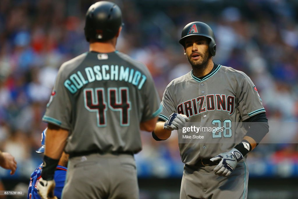 J.D. Martinez #28 of the Arizona Diamondbacks is greeted by Paul Goldschmidt #44 after hitting a 3-run home run in the first inning against the New York Mets at Citi Field on August 22, 2017 in the Flushing neighborhood of the Queens borough of New York City.