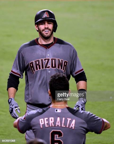 D Martinez of the Arizona Diamondbacks reacts as he returns to the dugout after his fourth homerun of the game to take a 130 lead over the Los...