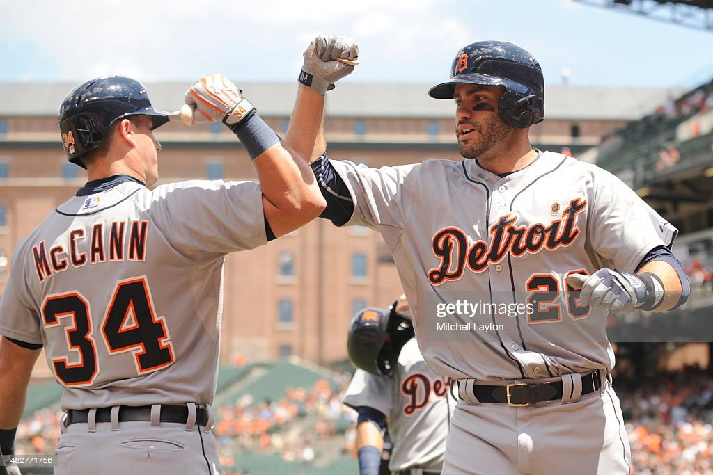 D Martinez of the Detroit Tigers celebrates a three run home run with James McCann in the first inning during a baseball game against the Baltimore...
