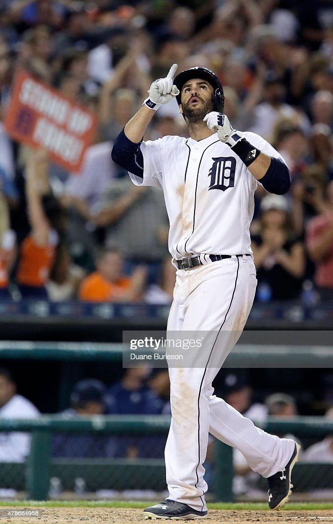 D Martinez of the Detroit Tigers celebrates his solo home run in the eighth inning that broke a 44 tie with the Chicago White Sox at Comerica Park on...