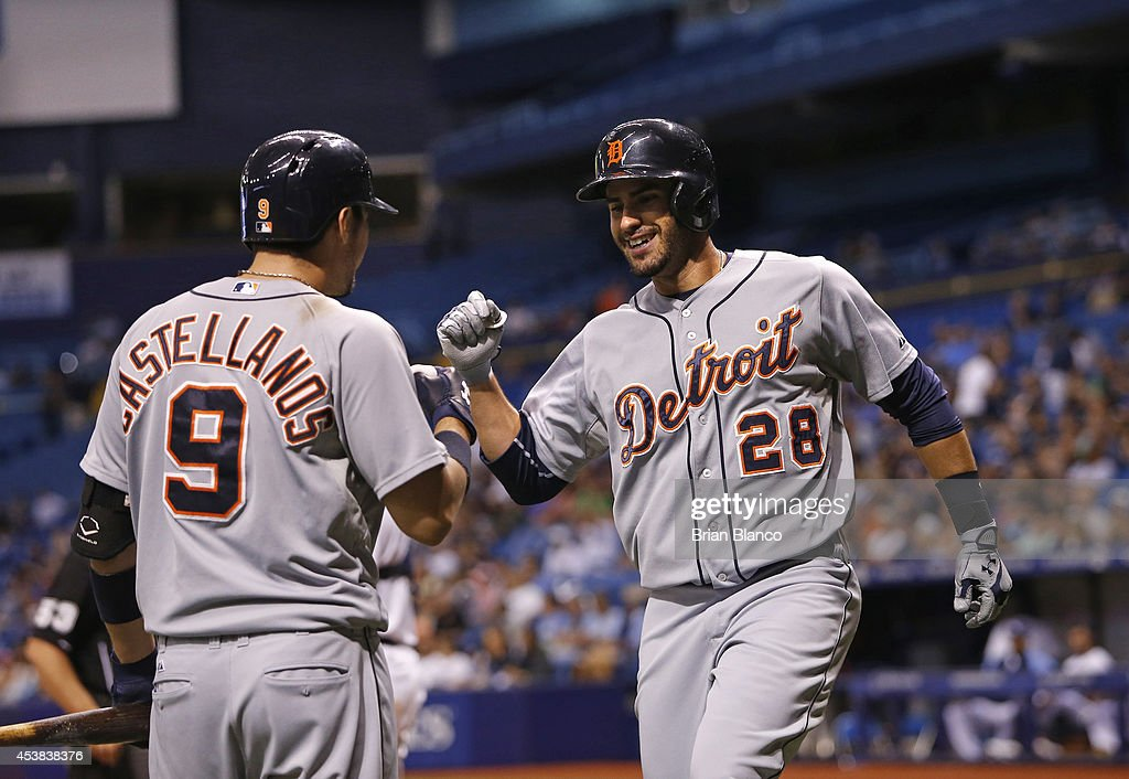 <a gi-track='captionPersonalityLinkClicked' href=/galleries/search?phrase=J.D.+Martinez&family=editorial&specificpeople=7520024 ng-click='$event.stopPropagation()'>J.D. Martinez</a> #28 of the Detroit Tigers celebrates his solo home run with teammate <a gi-track='captionPersonalityLinkClicked' href=/galleries/search?phrase=Nick+Castellanos&family=editorial&specificpeople=6129175 ng-click='$event.stopPropagation()'>Nick Castellanos</a> #9 as he makes his way back to the dugout during the eighth inning of a game against the Tampa Bay Rays on August 19, 2014 at Tropicana Field in St. Petersburg, Florida.