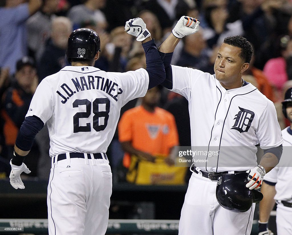 D Martinez of the Detroit Tigers celebrates his tworun home run against the Cleveland Indians with Miguel Cabrera during the fourth inning at...