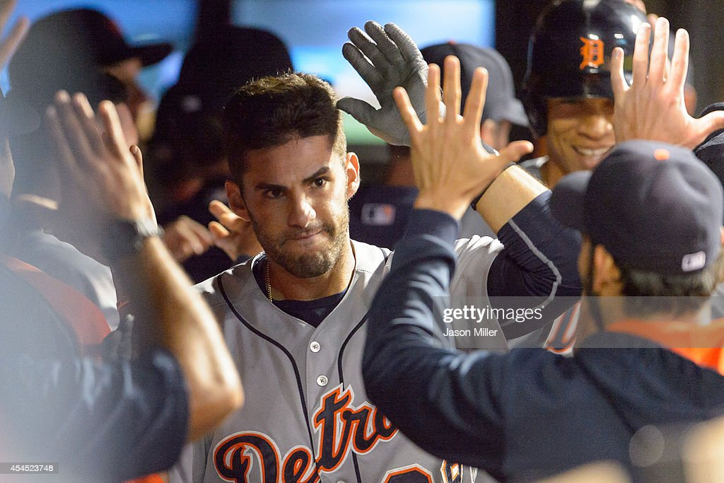 <a gi-track='captionPersonalityLinkClicked' href=/galleries/search?phrase=J.D.+Martinez&family=editorial&specificpeople=7520024 ng-click='$event.stopPropagation()'>J.D. Martinez</a> #28 of the Detroit Tigers celebrates in the dugout after hitting a three-run home run during the ninth inning against the Cleveland Indians at Progressive Field on September 2, 2014 in Cleveland, Ohio. The Tigers defeated the Indians 4-2.