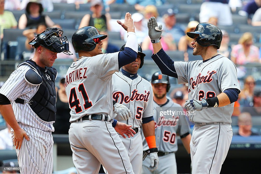 D Martinez of the Detroit Tigers celebrates with Victor Martinez after hitting his third home run of the game in the sixth inning against the New...