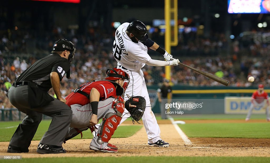 D Martinez of the Detroit Tigers doubles scoring Victor Martinez during the sixth inning of the game against the Los Angeles Angels on August 27 2016...
