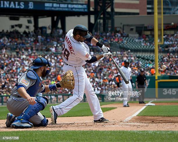 D Martinez of the Detroit Tigers hits a homerun in the first inning against the Toronto Blue Jays during a MLB game at Comerica Park on July 4 2015...