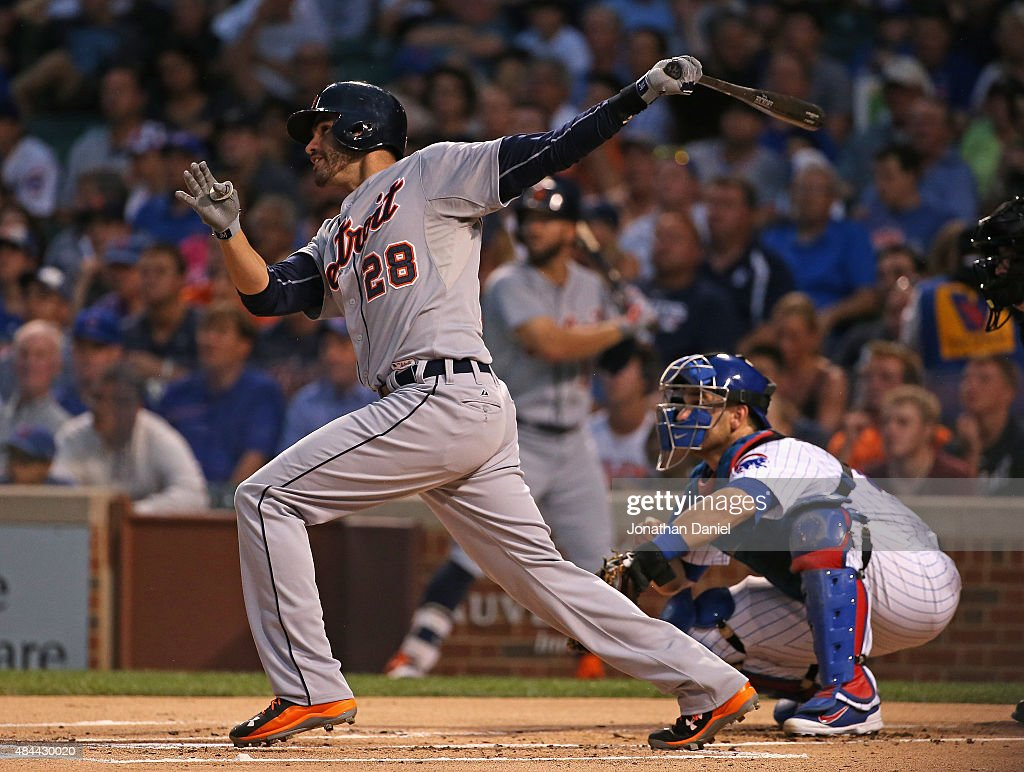 D Martinez of the Detroit Tigers hits a tworun home run in the 1st inning against the Chicago Cubs at Wrigley Field on August 18 2015 in Chicago...