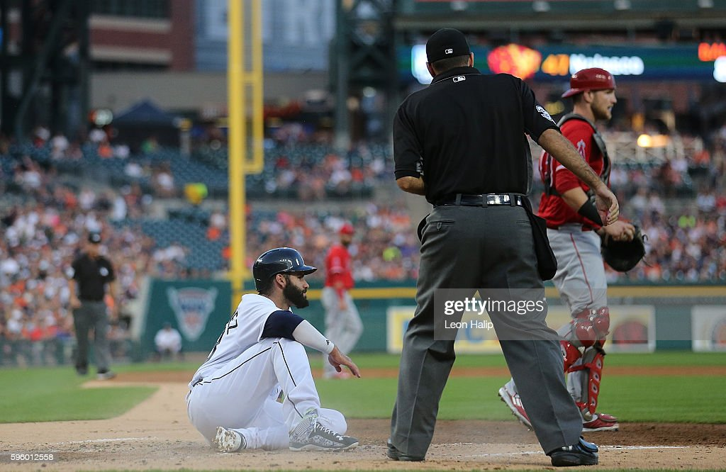 D Martinez of the Detroit Tigers is tagged out at home by catcher Jett Bandy of the Los Angeles Angels during the second inning of the game against...