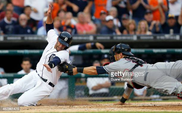 D Martinez of the Detroit Tigers is tagged out by catcher Yan Gomes of the Cleveland Indians while trying to score from first base on a double by...