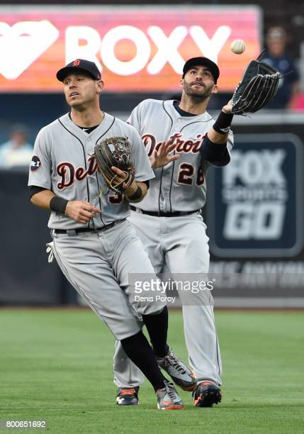 D Martinez of the Detroit Tigers makes a catch on a ball hit by Franchy Cordero of the San Diego Padres as Ian Kinsler looks on during the second...