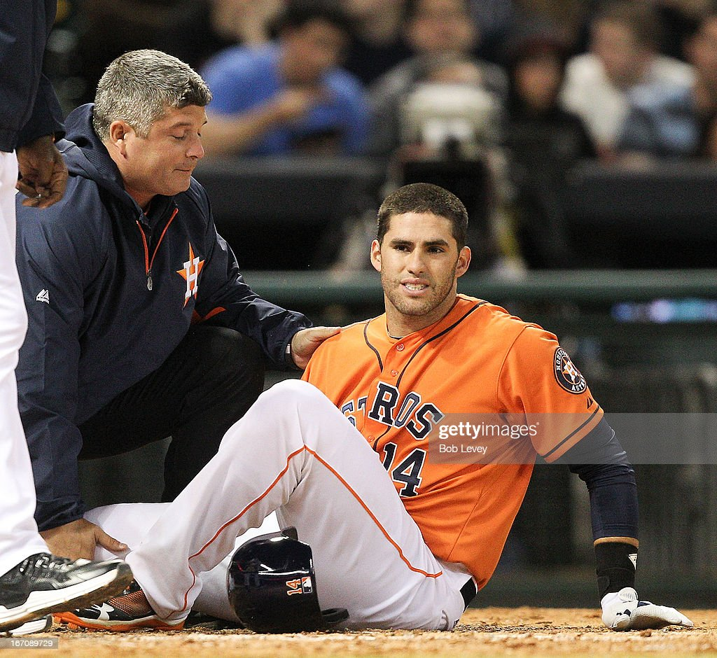 <a gi-track='captionPersonalityLinkClicked' href=/galleries/search?phrase=J.D.+Martinez&family=editorial&specificpeople=7520024 ng-click='$event.stopPropagation()'>J.D. Martinez</a> #14 of the Houston Astros is helped by trainer Nate Lucero after injuring his right knee while batting in the fourth inning against the Cleveland Indians at Minute Maid Park on April 19, 2013 in Houston, Texas.