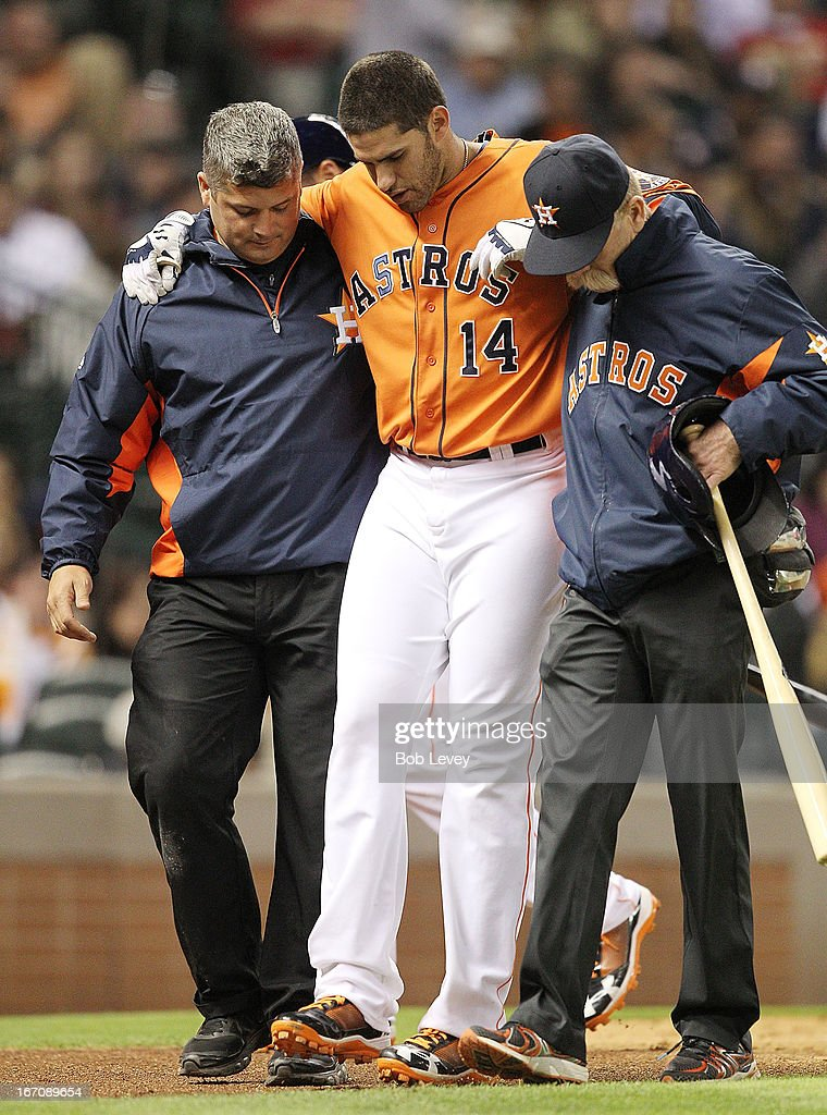 <a gi-track='captionPersonalityLinkClicked' href=/galleries/search?phrase=J.D.+Martinez&family=editorial&specificpeople=7520024 ng-click='$event.stopPropagation()'>J.D. Martinez</a> #14 of the Houston Astros is helped off the field by trainers Rex Jones, right, and Nate Lucero after injuring his right knee while batting in the fourth inning against the Cleveland Indians at Minute Maid Park on April 19, 2013 in Houston, Texas.