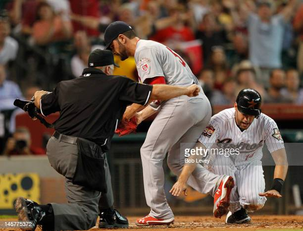 D Martinez of the Houston Astros scores on a wild pitch against the St Louis Cardinals as Jaime Garcia waits for the ball on June 5 2012 at Minute...