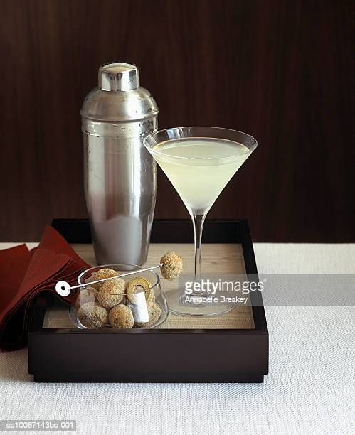 Martini cocktail and stuffed olives