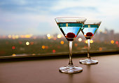 Martini cocktail glasses with a city view.
