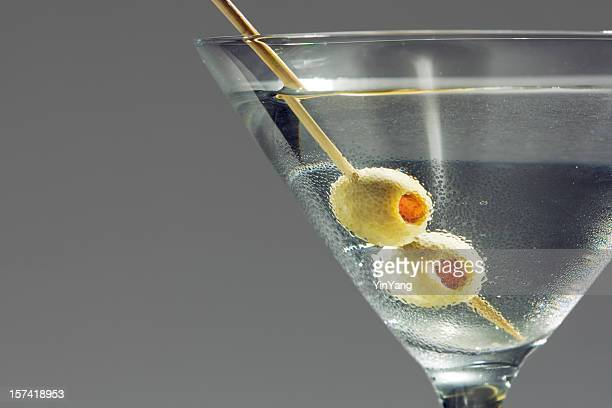 Martini Glass Cocktail Drink with Olives Skewered by Toothpick Close-up
