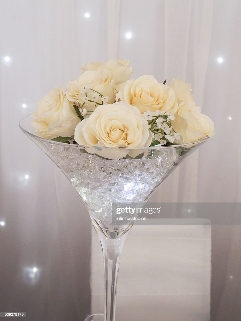 Martini Glass Table Decoration With Cream Flowers, Stars, Diamonds : Stock  Photo