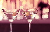 Pair of martini glasses in a night club.