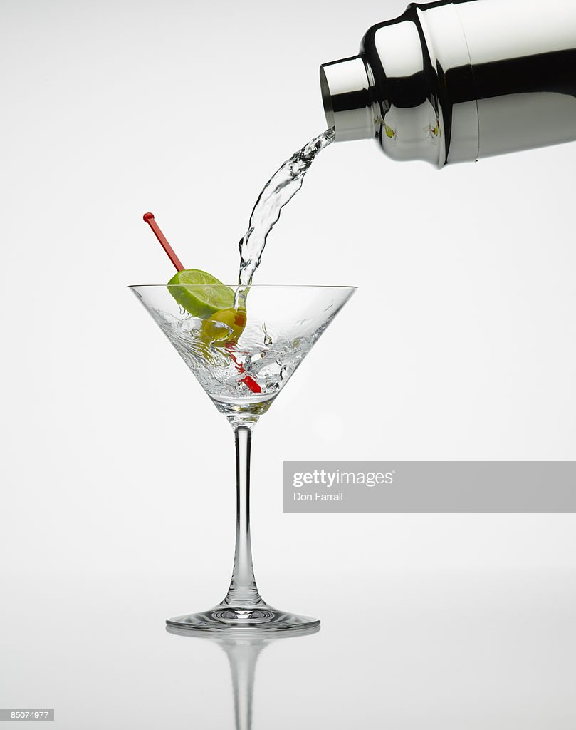 Martini pour lime and olive : Stock Photo