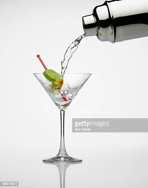 Martini pour lime and olive