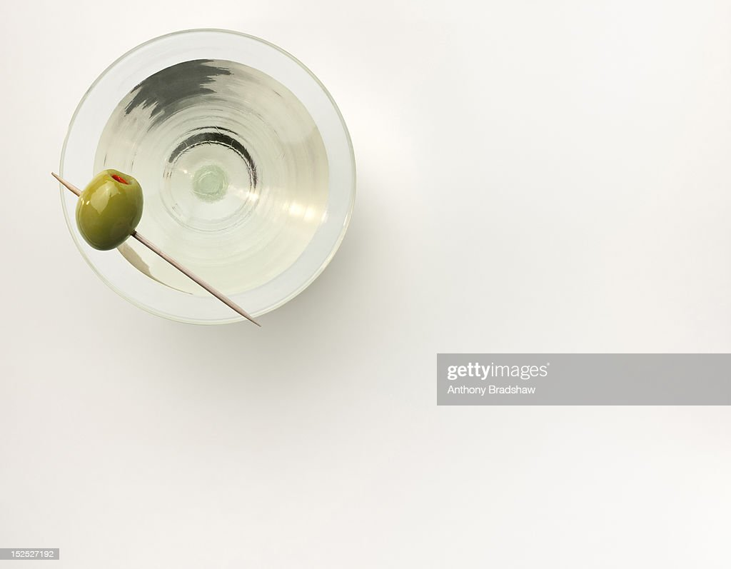 A martini served with a stuffed olive