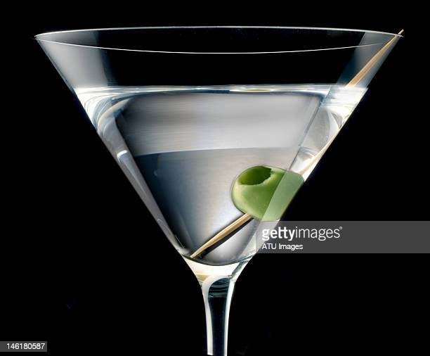 A martini with an olive