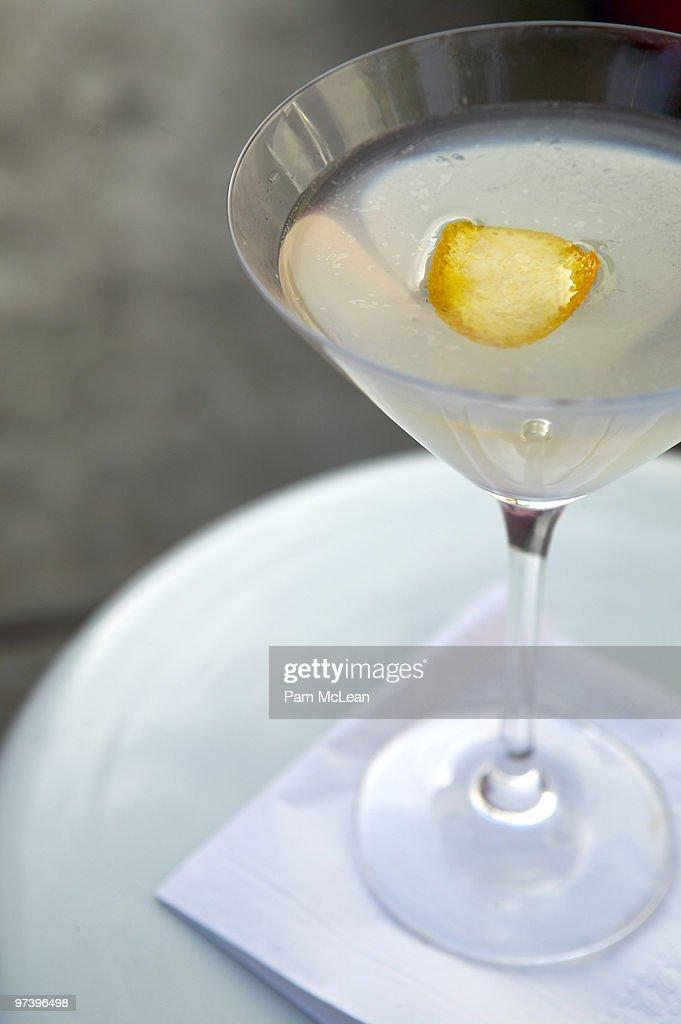 Martini with orange rind : Stock Photo