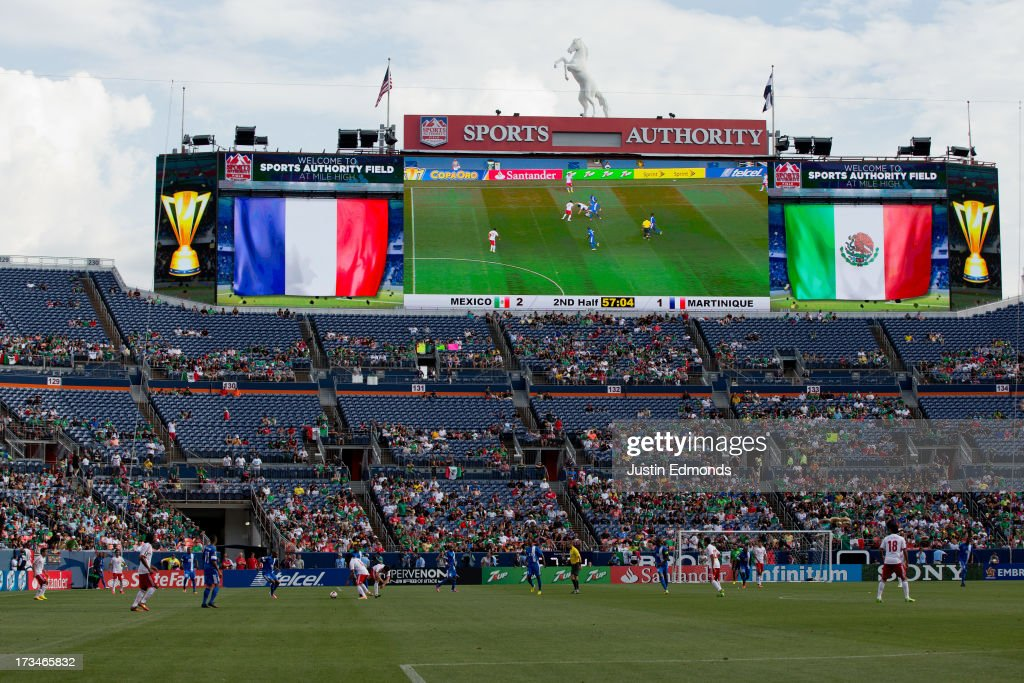 Martinique takes on Mexico during the second half of a CONCACAF Gold Cup match at Sports Authority Field at Mile High on July 14, 2013 in Denver, Colorado. Mexico defeated Martinique 3-1.