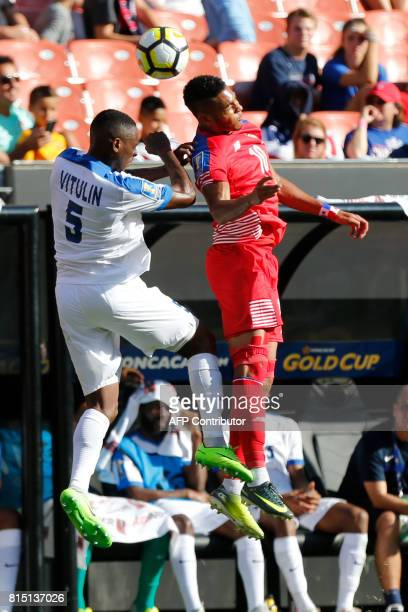 Martinique's Karl Vitulin and Panama's Ismael Diaz jump for a header during the second half of a CONCACAF Gold Cup soccer match in Cleveland Ohio on...