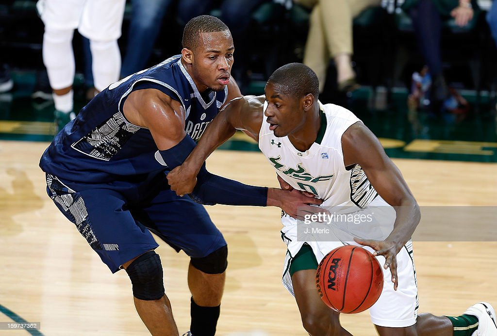 Martino Brock #0 of the South Florida Bulls drives as Jabril Trawick #55 of the Georgetown Hoyas defends during the game at the Sun Dome on January 19, 2013 in Tampa, Florida.